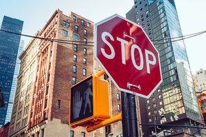 Stop traffic sign and pedestrian walk don't walk signal in midtown Manhattan.