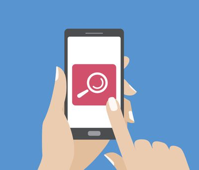 Hand holding smartphone and touching the screen with search button. Magnifying glass icon.