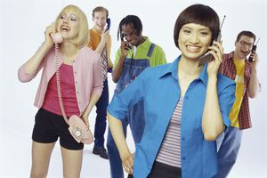 An image of people talking on both landline phones and cellphones.