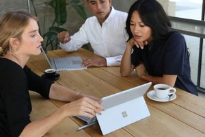 People in business meeting using Surface Pro 6