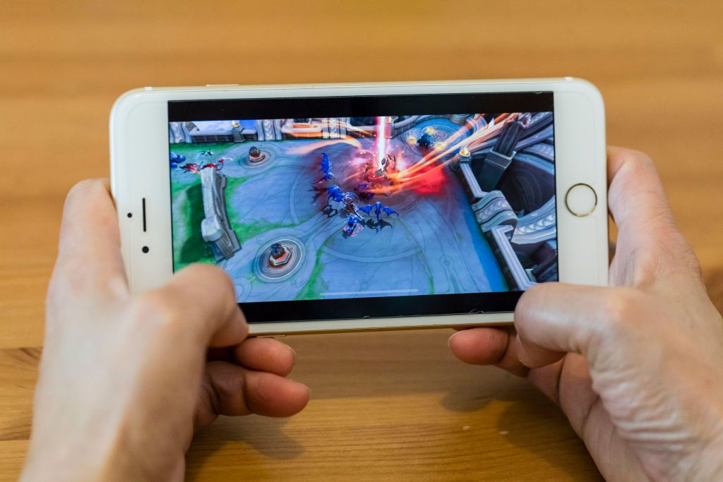 Closeup of someone gaming on a smartphone.