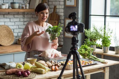 Woman filming a cooking show