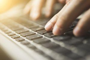A woman using a keyboard.