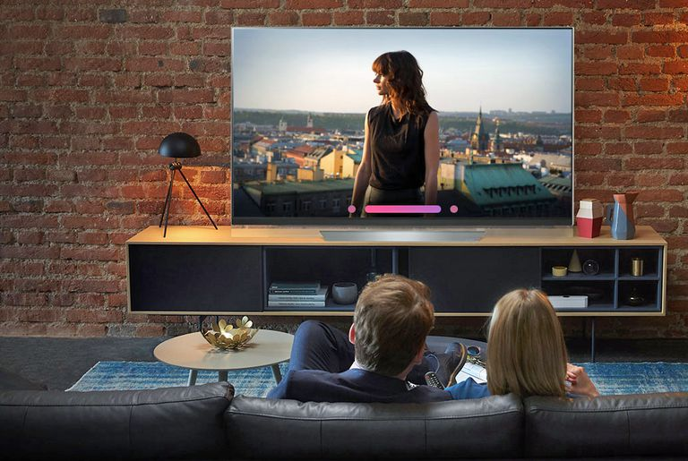 Couple watching LG OLED TV