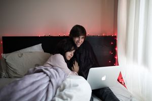 Couple watching streaming media on laptop