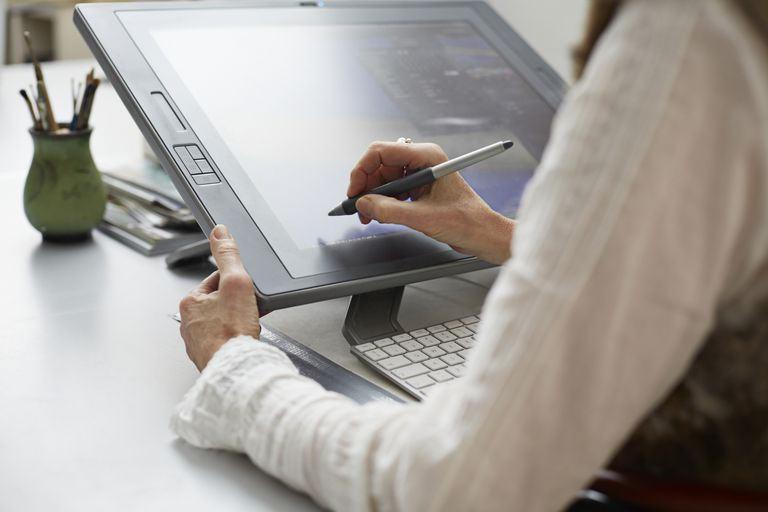 Woman drawing on tablet with stylus