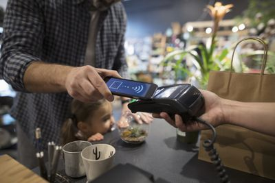 Paying with a smartphone at the register.