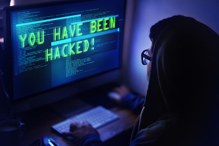Person sitting at hacked computer