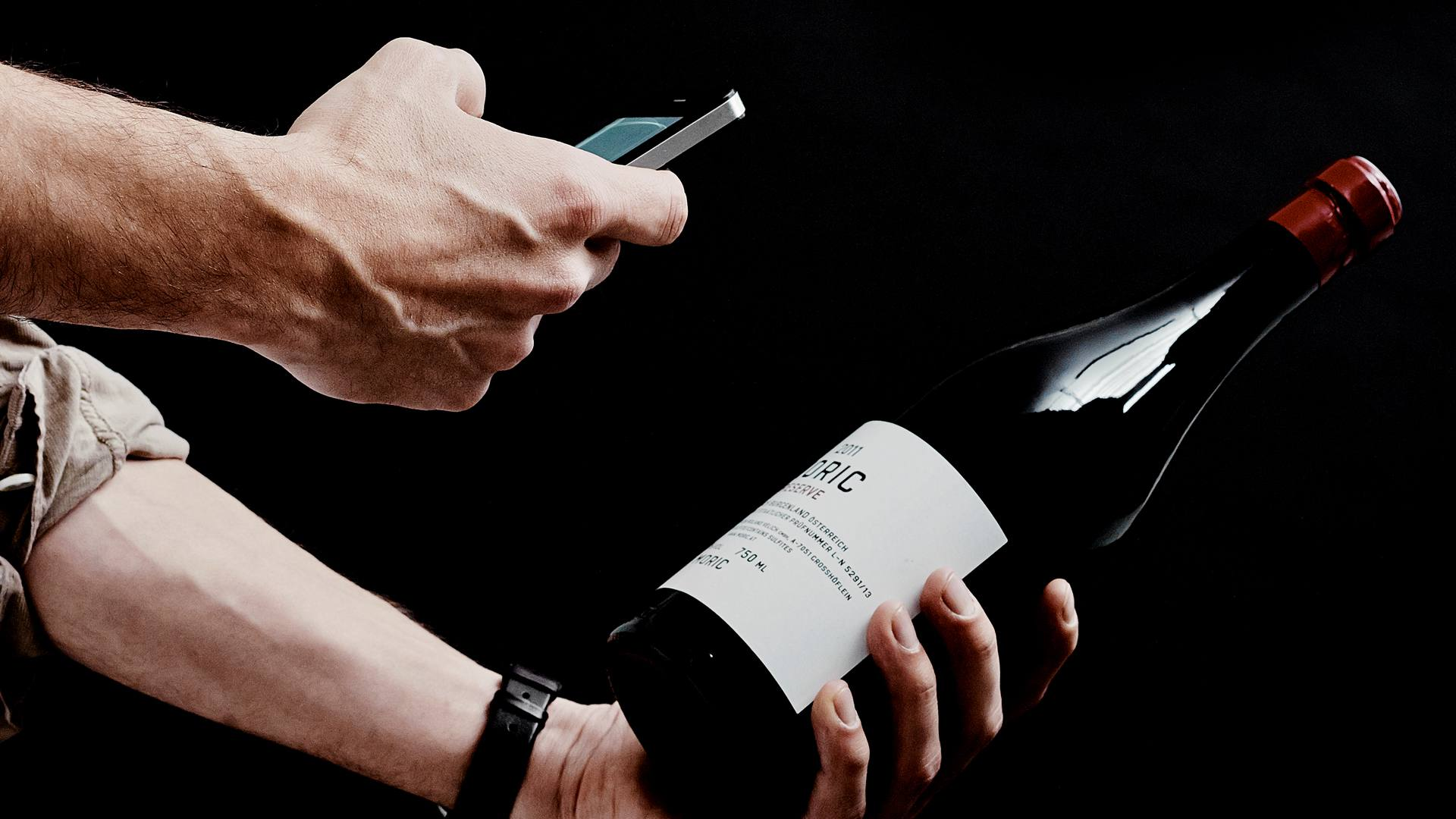 The Vivino Vivino wine app being used on an iPhone to scan a wine bottle label.