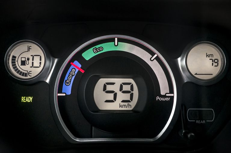 Electric car instrument cluster showing charge status nearly full.