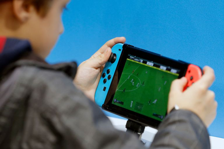 A child playing FIFA 19 on a Nintendo Switch