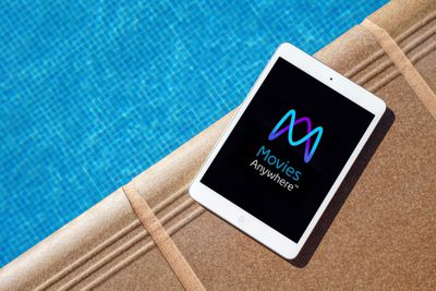 iPad with Movies Anywhere logo by the pool