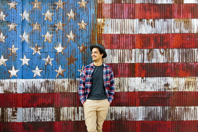 Smiling man against American flag background