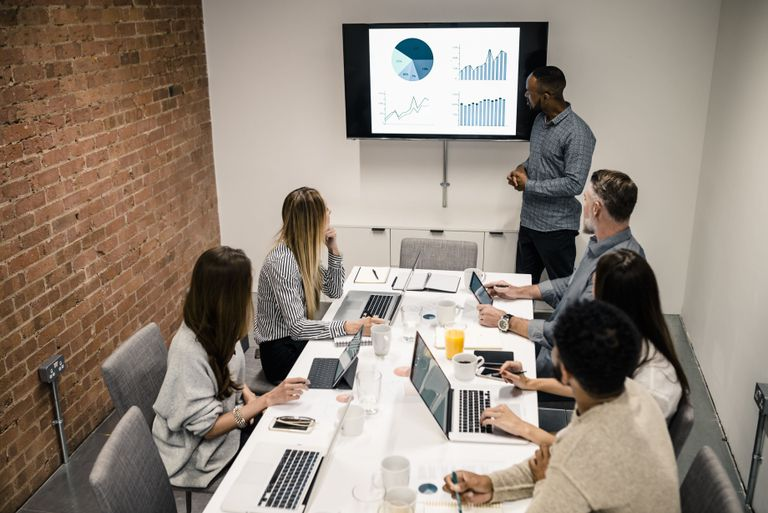 business people having a meeting with powerpoint presentation