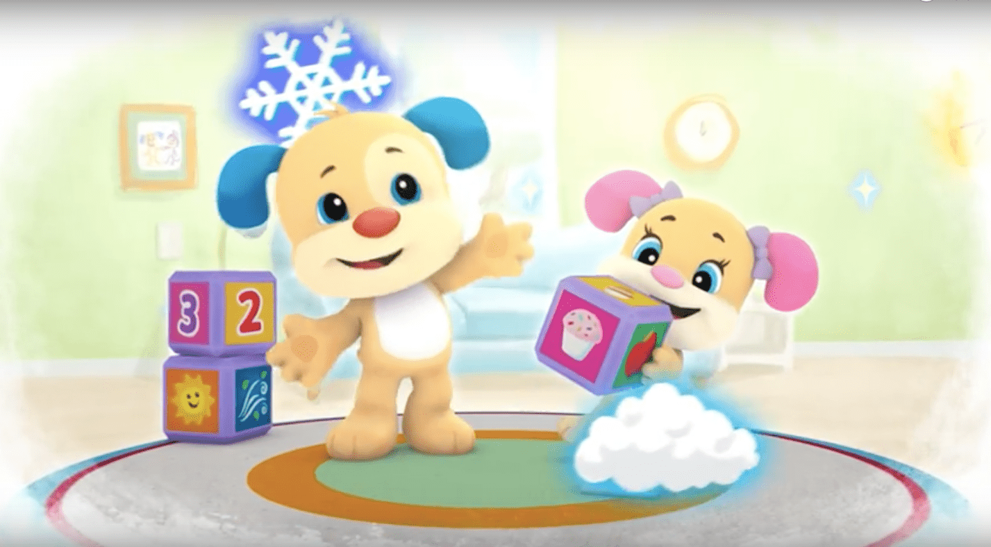 Two puppies are holding blocks and talking to each other.