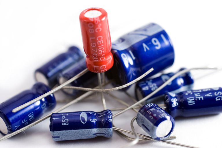 Collection of capacitors against a white background