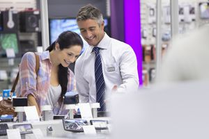 A customer talking to a sales representative about digital cameras.