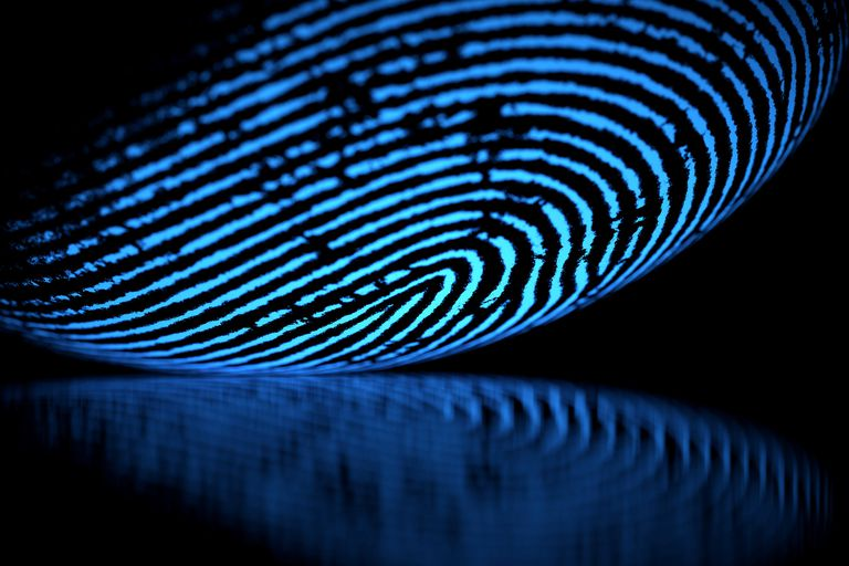 Large fingerprint glowing blue