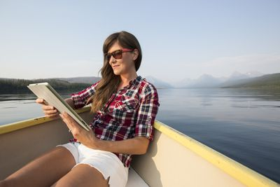 Woman reading on a boat.