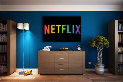 Nexflix LGBT logo on a wall mount TV in a bedroom