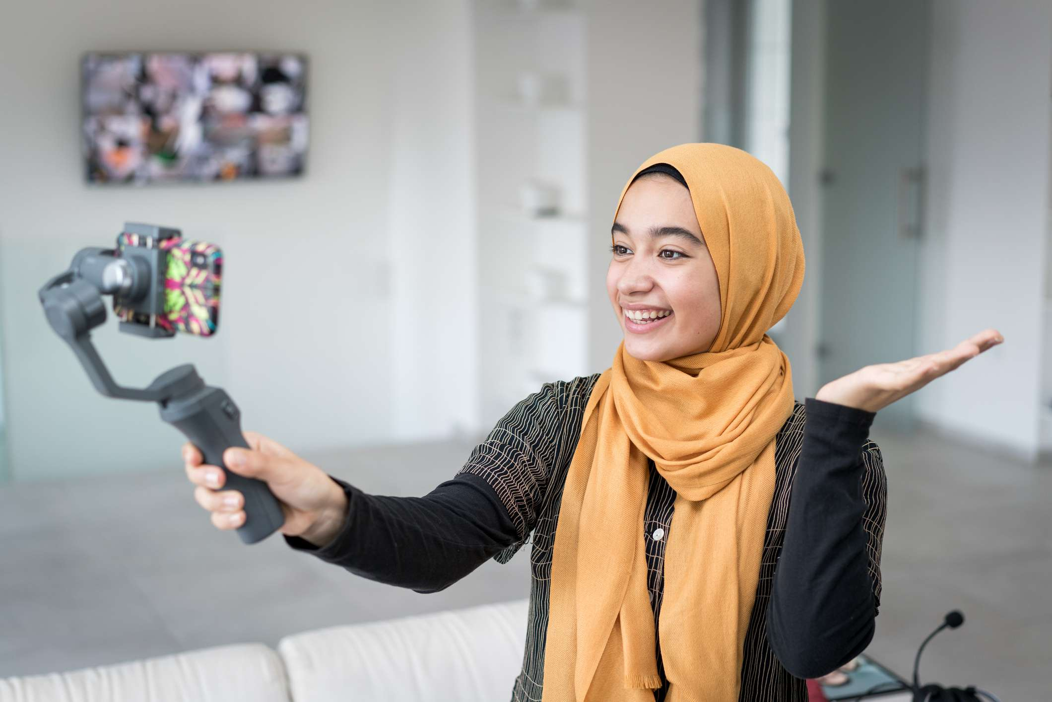 woman making video using smartphone and steady