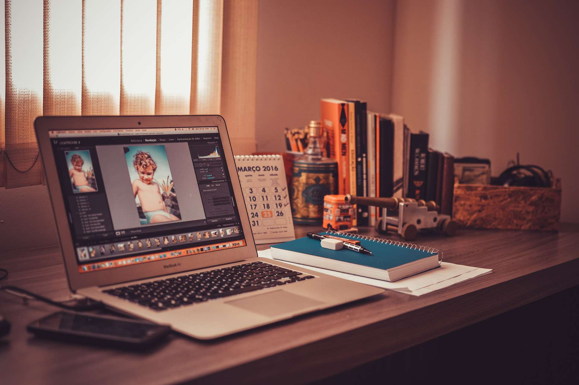Graphic design software on laptop in home office