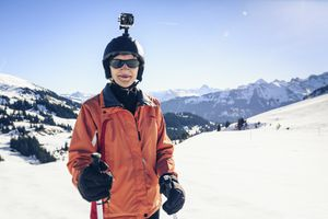 A skier wearing a GoPro on their helmet