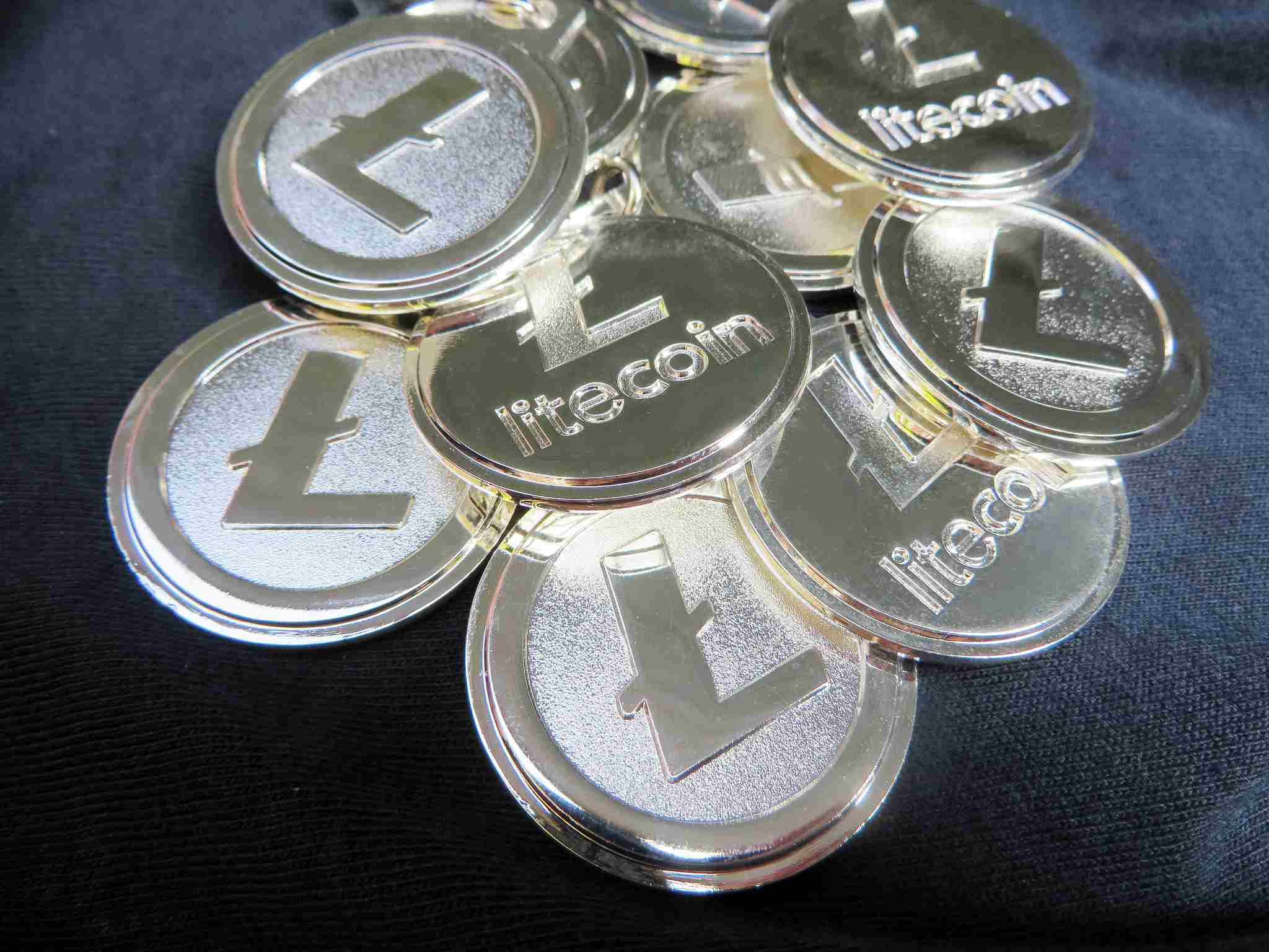 Pile of litecoin coins on fabric