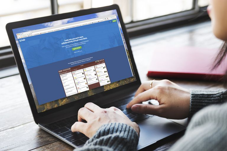 Woman using Trello on laptop