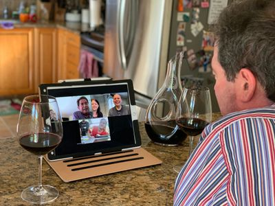 Friends participating in a Zoom meeting Virtual Happy Hour.