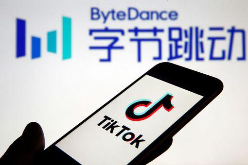 TikTok on smartphone screen in front of ByteDance logo