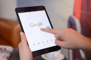 An image of a person doing a Google search on a tablet.