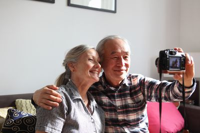 Older couple using a digital camera