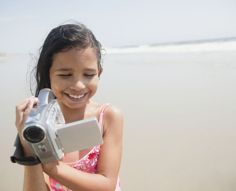 Young girl holding camcorder