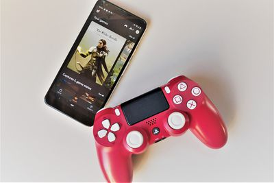 A PlayStation 4 controller and a Google Pixel phone with Google Stadia open