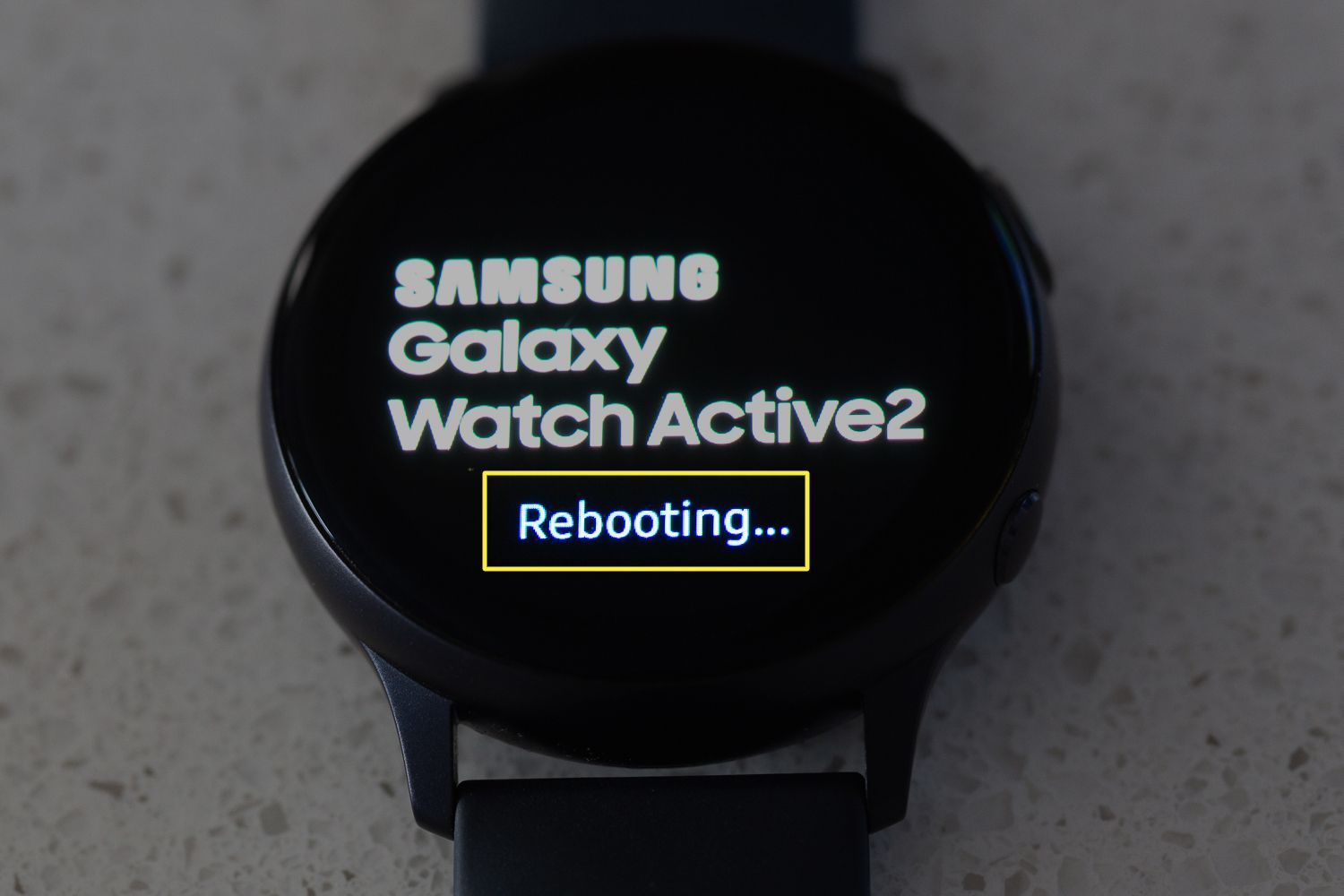 The rebooting message on a Samsung Galaxy Watch Active2 indicating a device reboot is in progress.