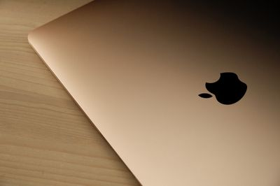 A MacBook Air with a gold finish