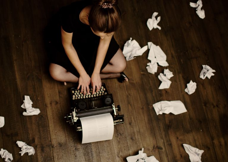 Writer working on typewriter on the floor