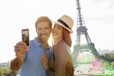 Young couple taking self photo in Paris