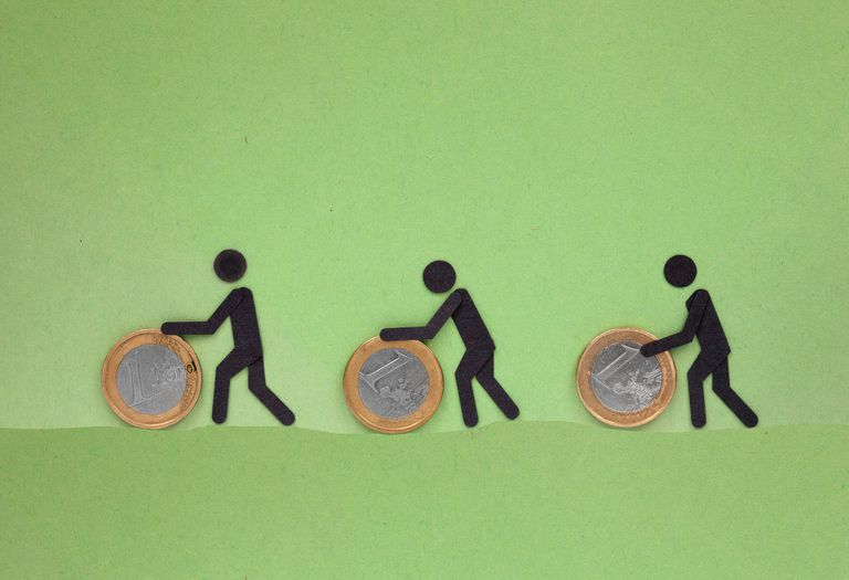 Cut out paper people pushing, rolling coins