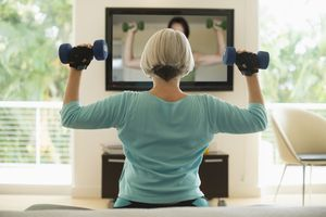 Woman exercising in front of TV