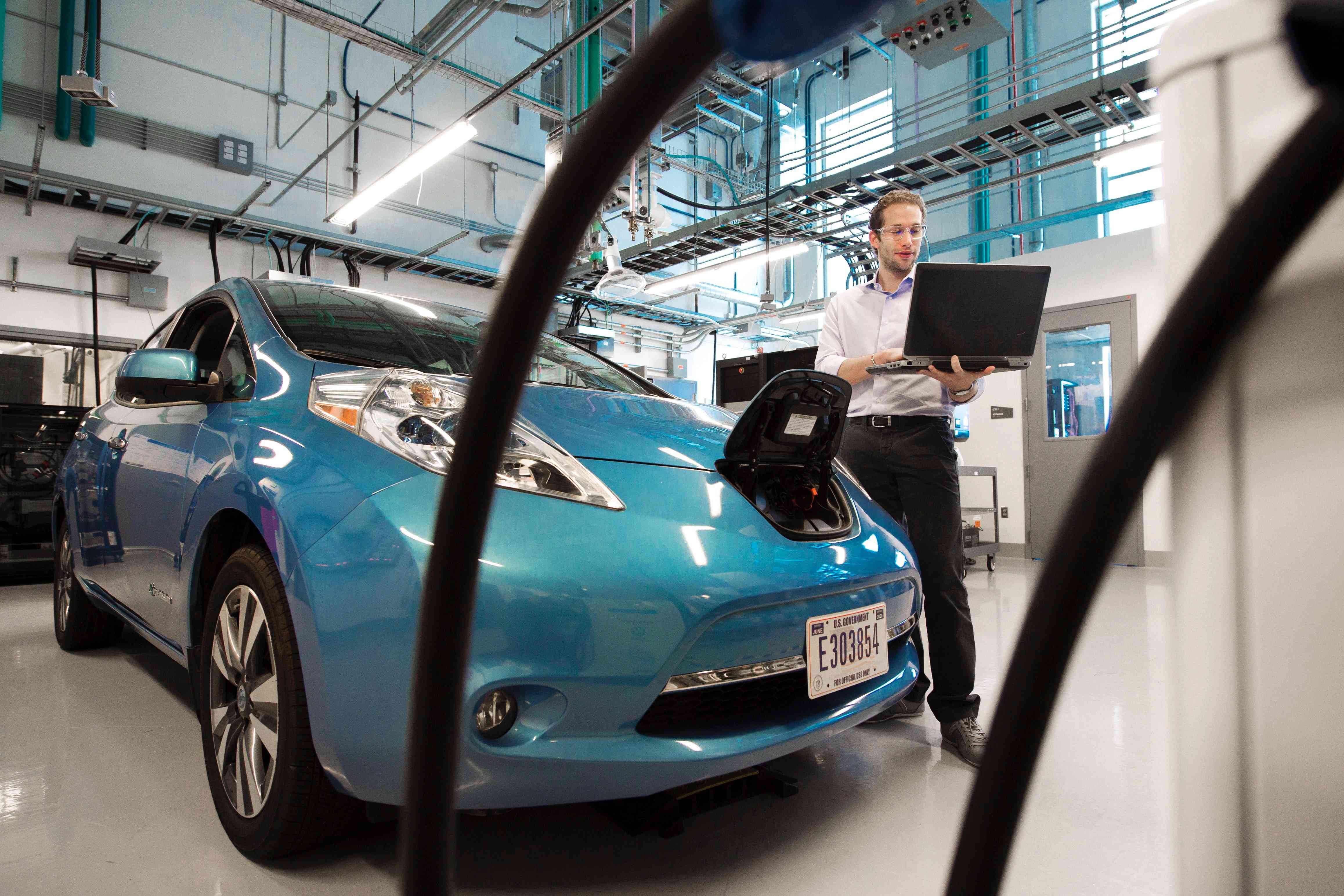 An electric vehicle in a repair shop.