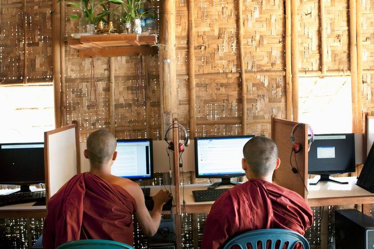 Monks at a computer