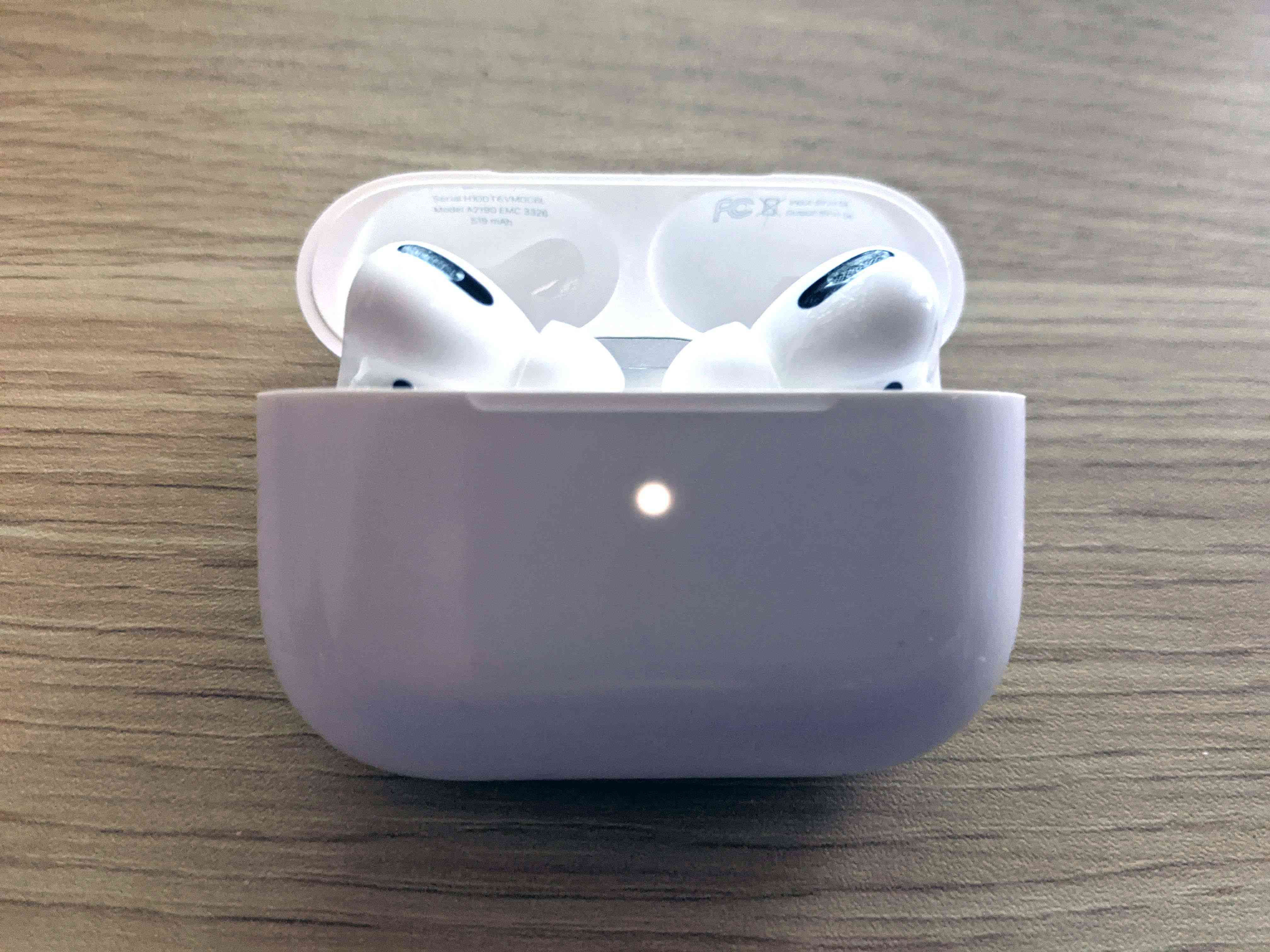 The flashing white light on an AirPods case indicating it's ready to pair.