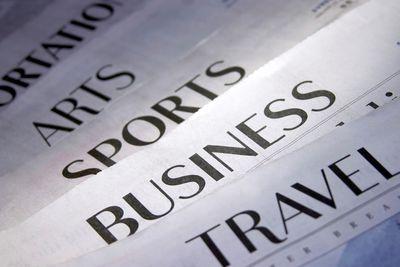 Newspaper headlines in a row