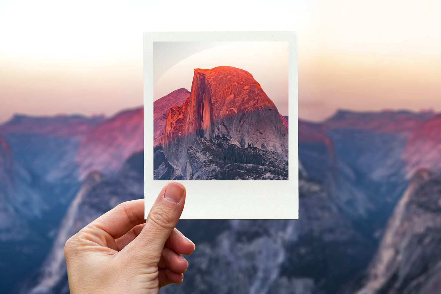 Framing the Half Dome in Yosemite during sunset with polaroid picture from personal perspective.