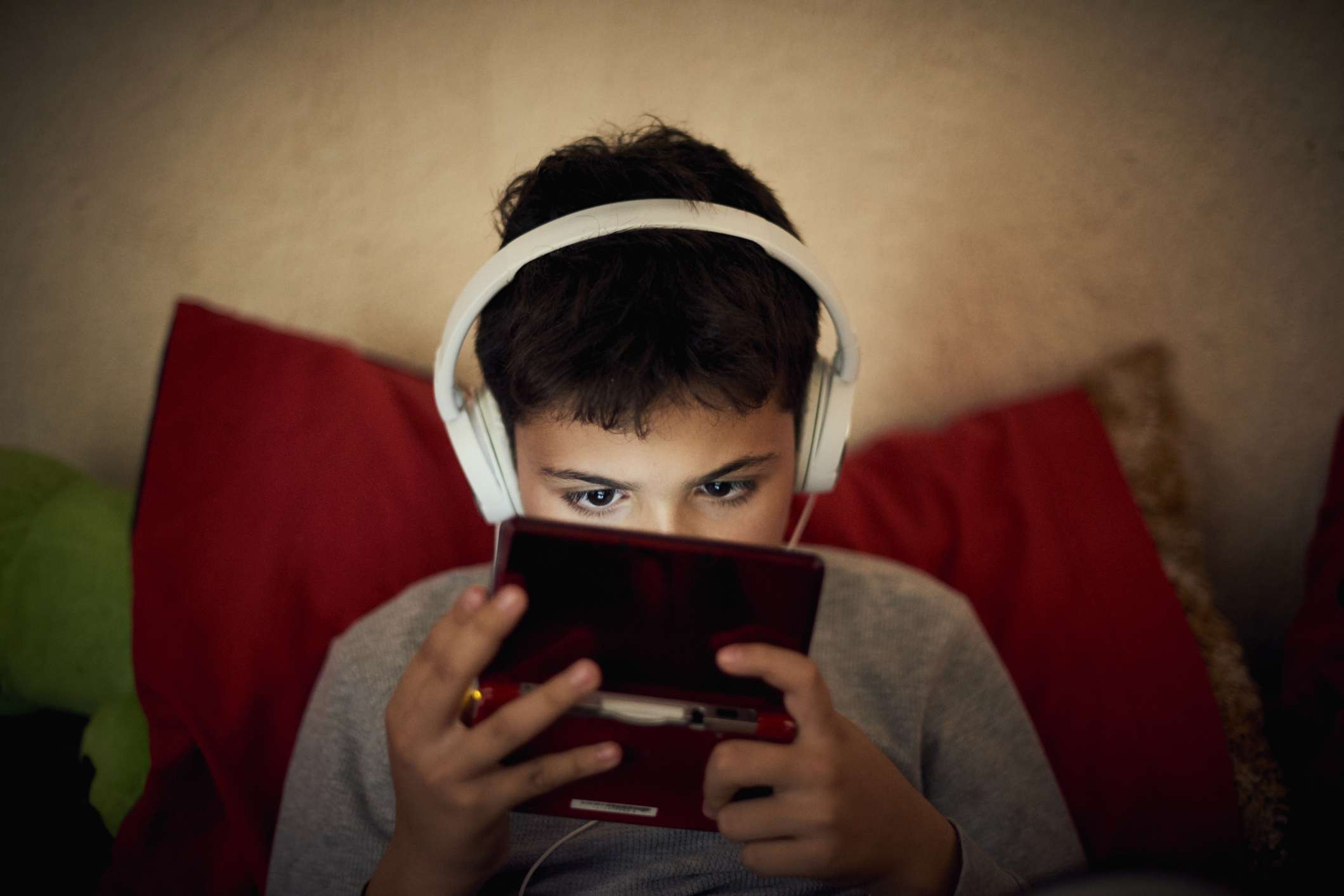 A child playing on a hand-held gaming system.