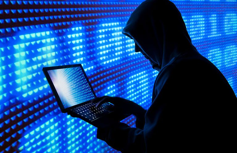 Hacker with blue screens and 1010