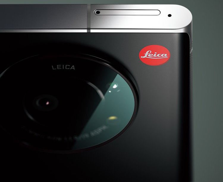 Leica's round camera module with red logo dot