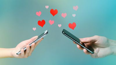 Two people sending messages to each other on the Tinder app from their smartphones.
